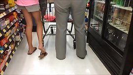 Legs and Feet Standing In Line