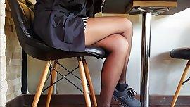 Sexy legs in shiny black pantyhose