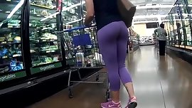 Ass in purple leggings